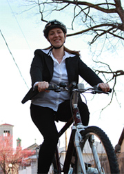 Photo of woman riding a bike to work